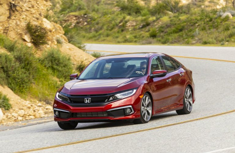 A head-on photo of the 2020 Honda Civic on the road.