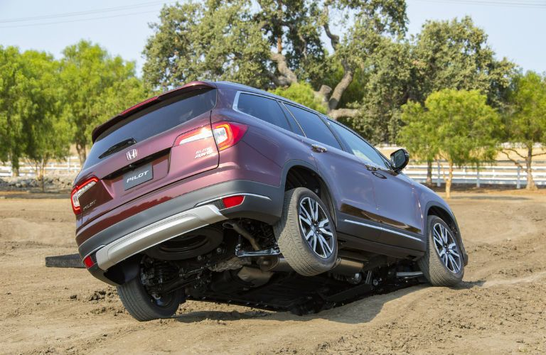 A photo of the 2020 Honda Pilot crossing an off-road course.