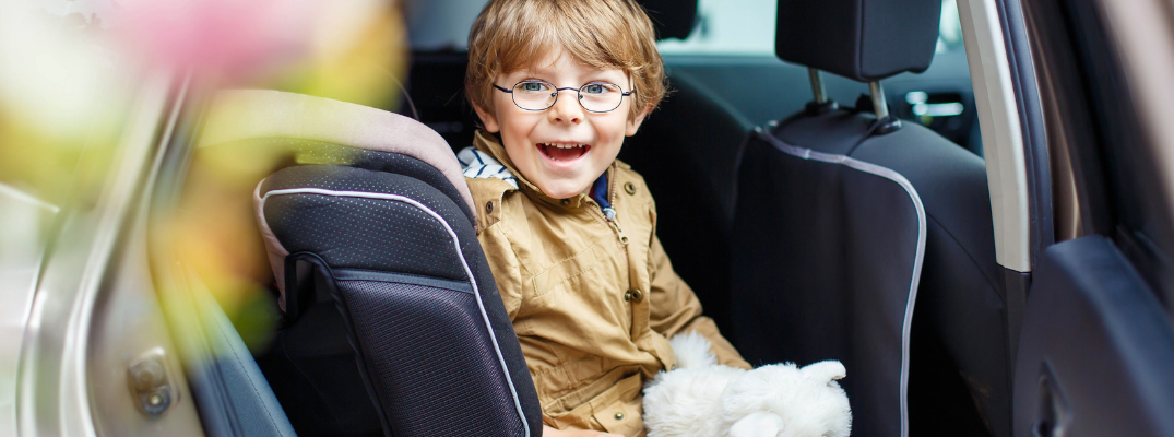 Child smiling in car seat