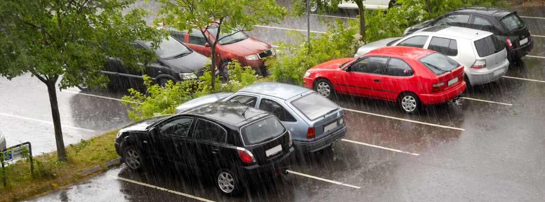 Vehicles parked in rain