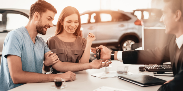 Couple purchasing vehicle at dealership