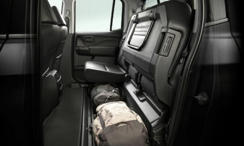 Rear seat up with luggage below it in 2020 Honda Ridgeline