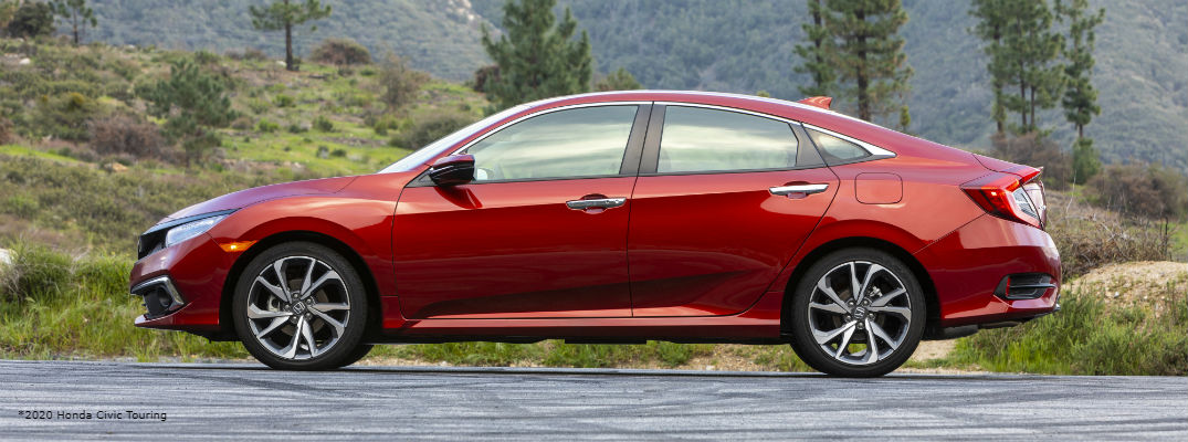 Side view of red 2020 Honda Civic Touring