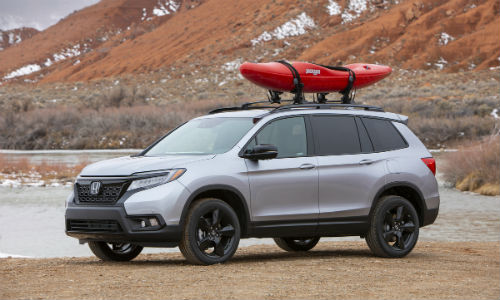 Silver 2021 Honda Passport with canoe on roof