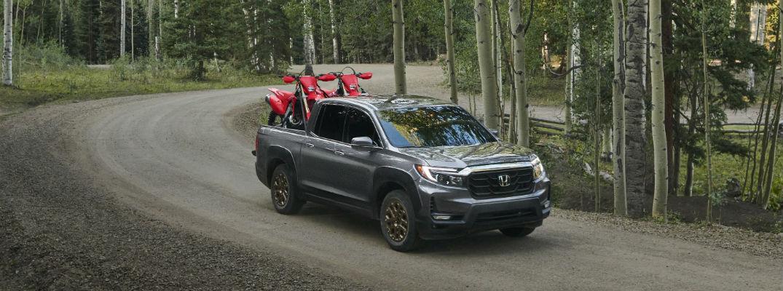 Gray 2021 Honda Ridgeline driving