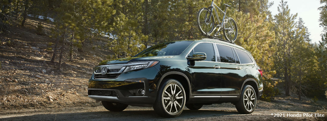 Green 2021 Honda Pilot Elite with bike on roof