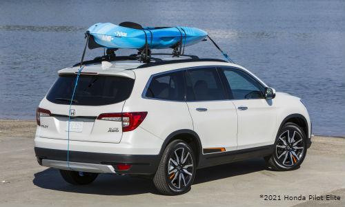 White 2021 Honda Pilot Elite with kayak on roof