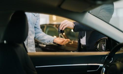Individuals exchanging car keys