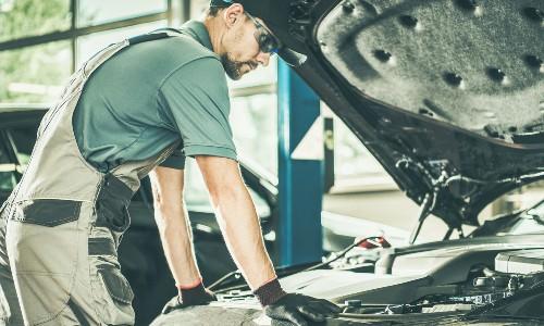 Mechanic looking into vehicle