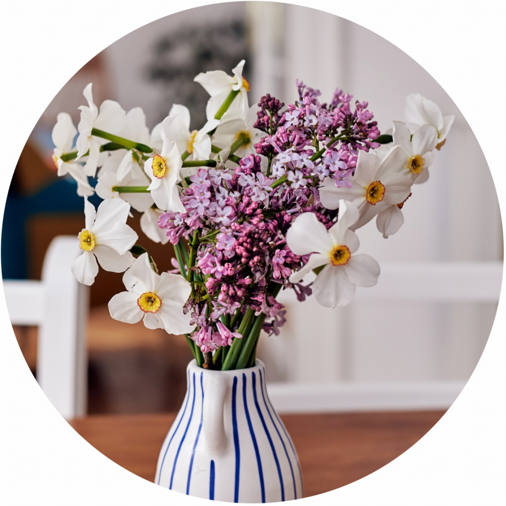 Fresh flowers in blue and white vase