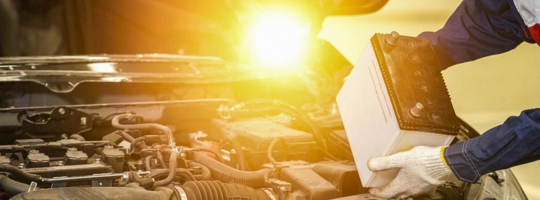 Mechanic changing vehicle battery