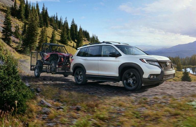 2021 Honda Passport towing a vehicle