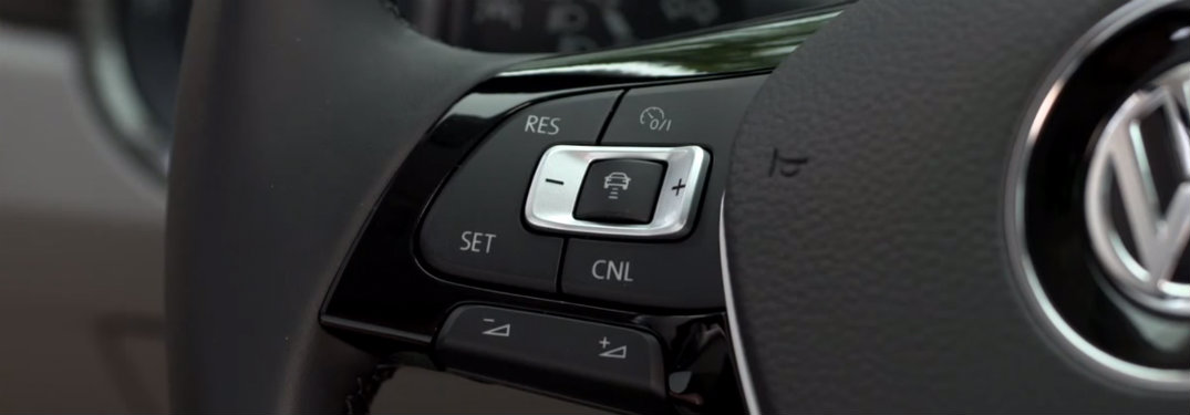 Adaptive cruise control buttons on a VW steering wheel