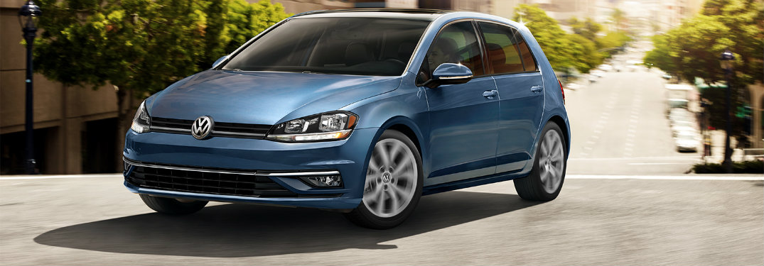 Silk Blue Metallic 2019 Volkswagen Golf driving uphill