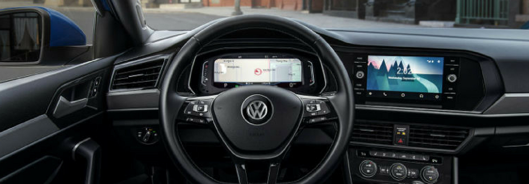 Interior view of the steering wheel and cruise control buttons inside a Volkswagen vehicle