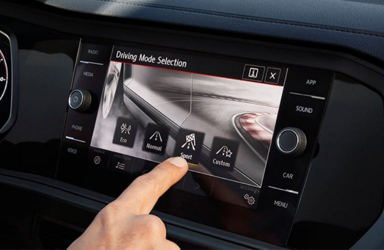 Image of a person using the Drive Mode Selector on the 2019 Volkswagen Jetta GLI touchscreen display