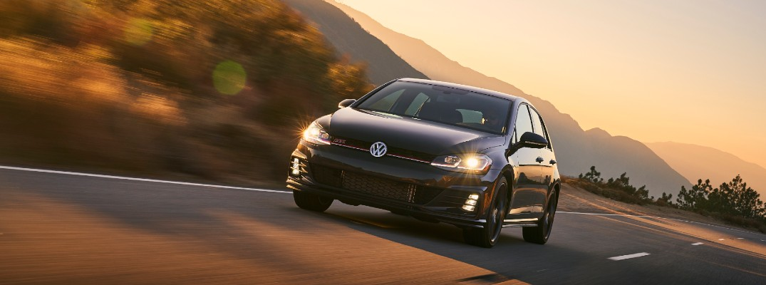 2020 Volkswagen Golf GTi driving at sunset