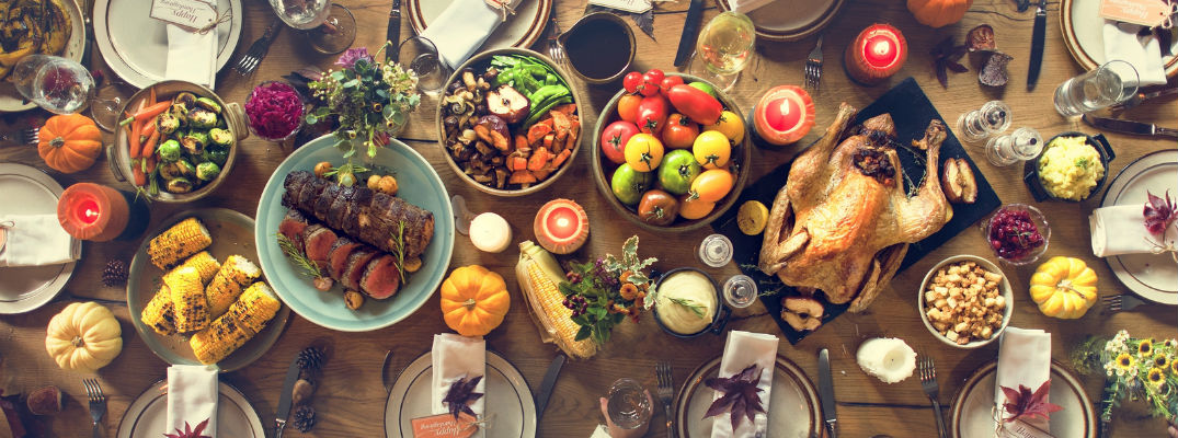 A top-down view of perfectly set Thanksgiving meal ready for a large group or family