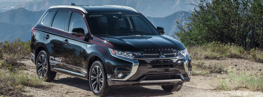 A front left quarter photo of the 2018 Mitsubishi Outlander PHEV parked near a bluff