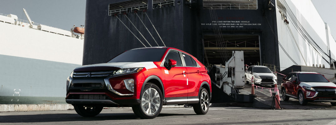 A photo of several models of the 2018 Mitsubishi Eclipse Cross being unloaded from a ship.