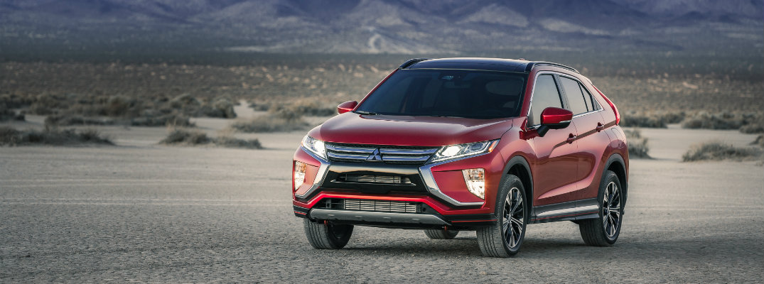 Red 2018 Mitsubishi Eclipse Cross on a desert landscape