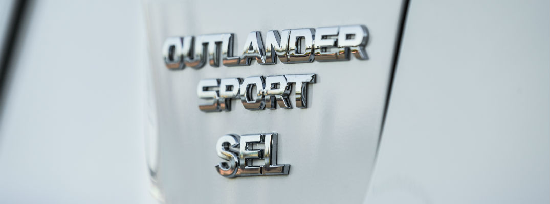A close up photo of the Outlander Sport badge worn by the 2018 Mitsubishi Outlander Sport.
