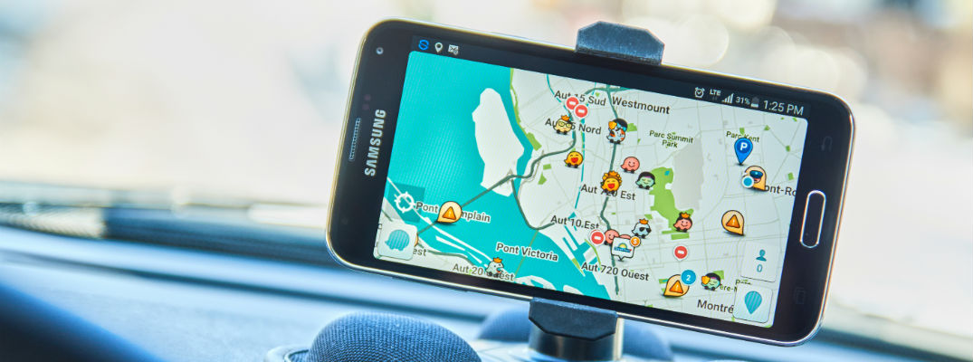 A stock photo of a person using a smartphone app for navigation.