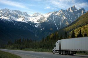 Trucker Driving Through Mountian