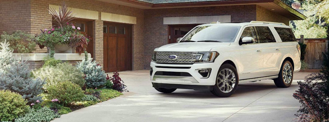 2018 Ford Expedition in front of a modern home