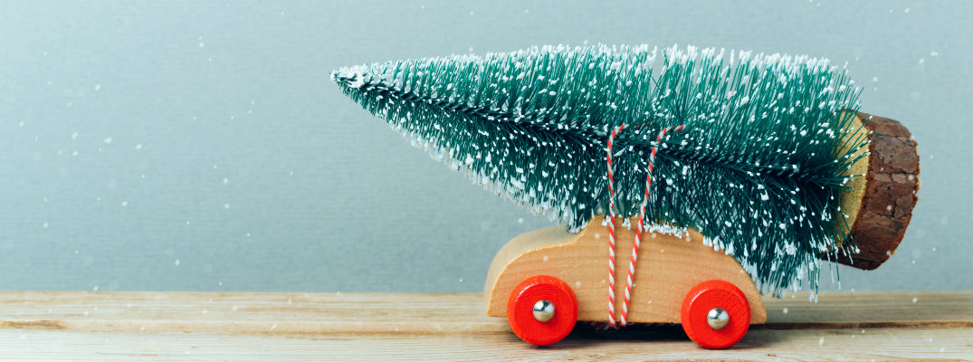 Toy car with a Christmas tree on the roof
