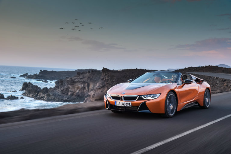 2019 BMW i8 driving by the ocean