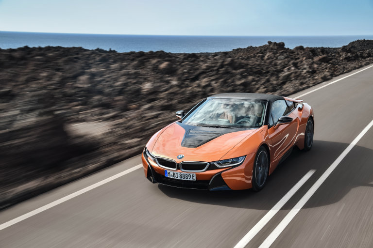 2019 BMW i8 driving away from the ocean