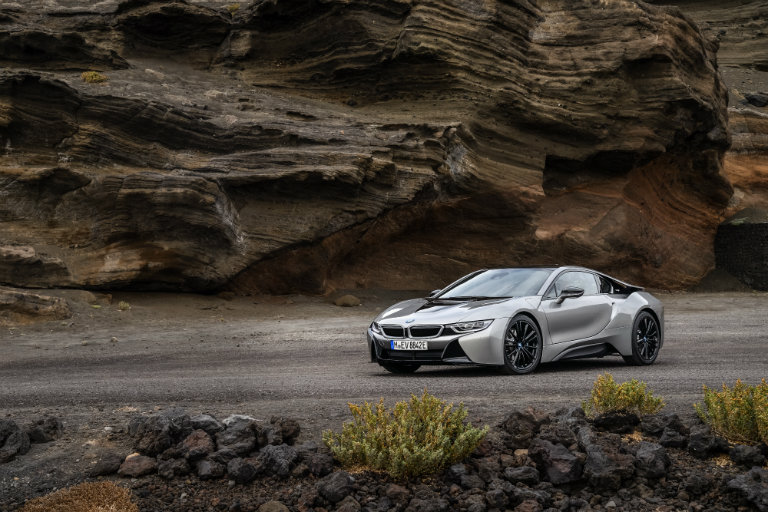 2019 BMW i8 by a rock cliff