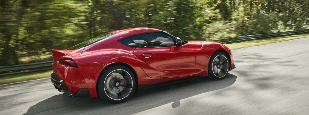 2020 Toyota Supra driving on a sunny day