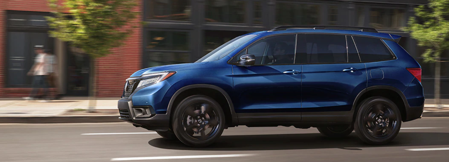 2019 Honda Passport driving downtown