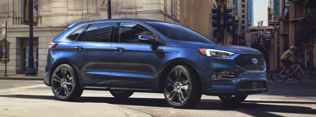 2020 Ford Edge driving downtown