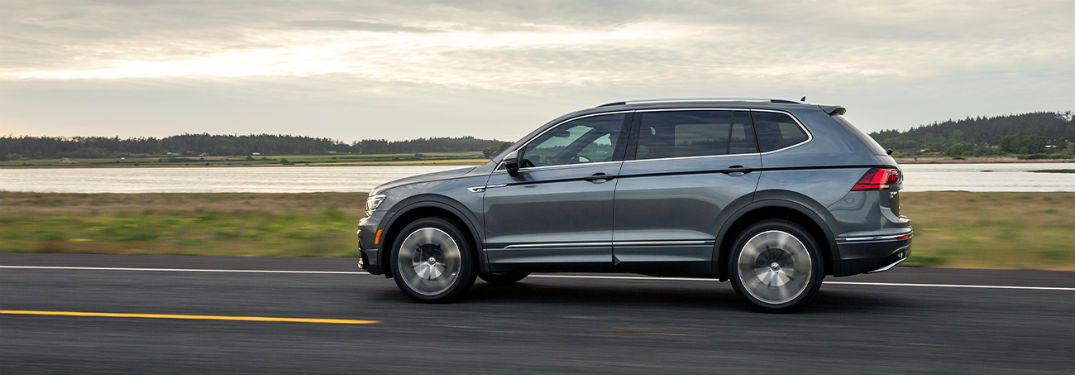 2020 VW Tiguan gray exterior driver side driving on country highway