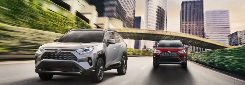 Two 2020 Toyota RAV4 driving down a city street