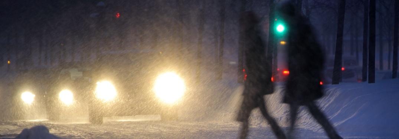 A couple crossing a street in winter