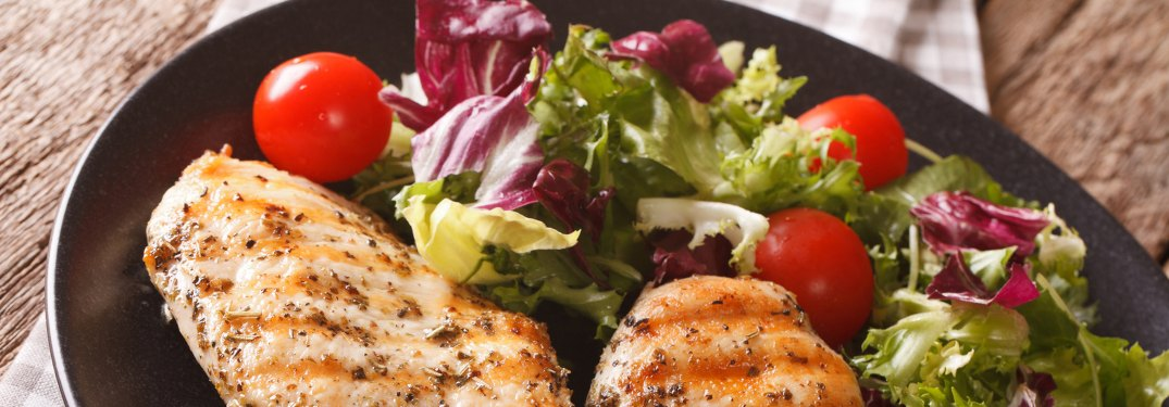 Close-up on a meal of grilled chicken and salad