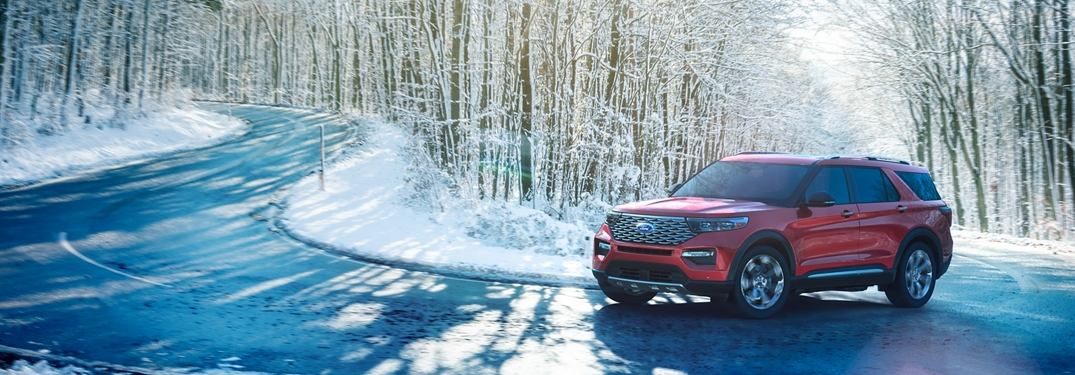 2020 Ford Explorer driving down a snowy road in the woods