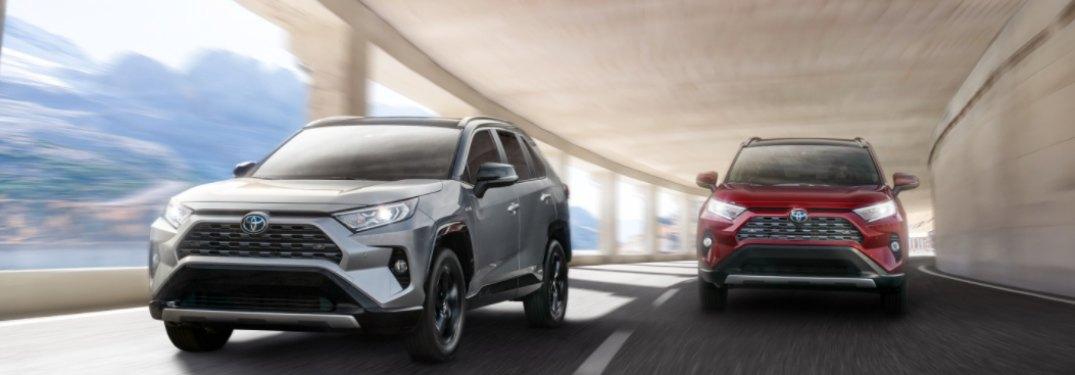 Two 2020 Toyota RAV4 models driving down a tunnel