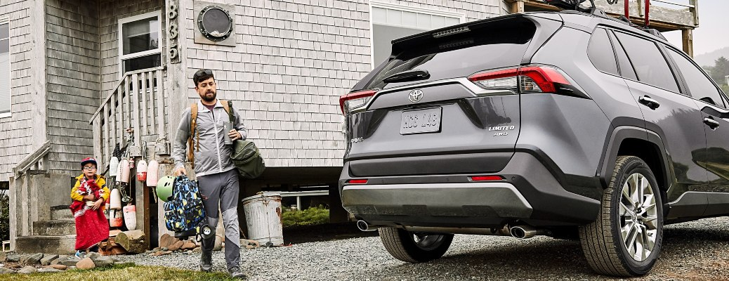 A family packing cargo into a 2021 Toyota RAV4
