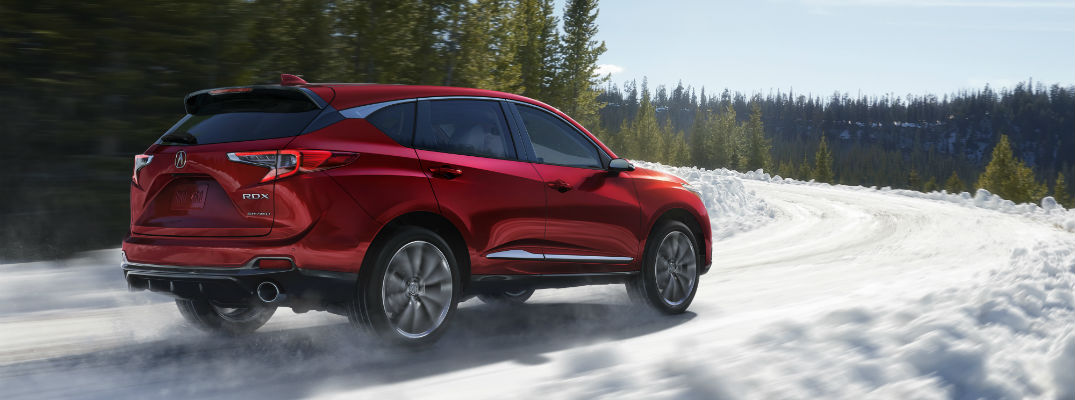 A right profile view of the Acura RDX prototype driving on a snowy road