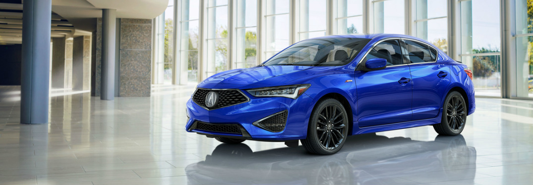 2019 Acura ILX in blue sitting in a showroom