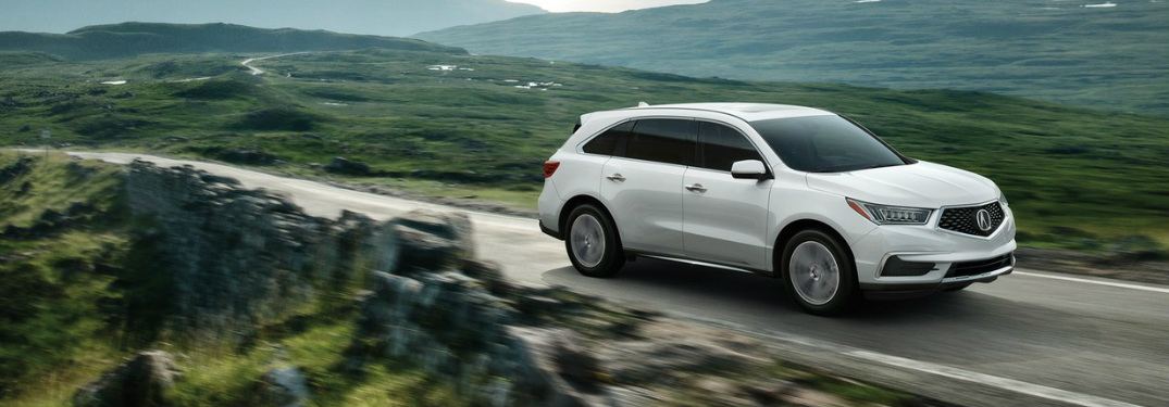 2019 Acura MDX in white driving through the countryside