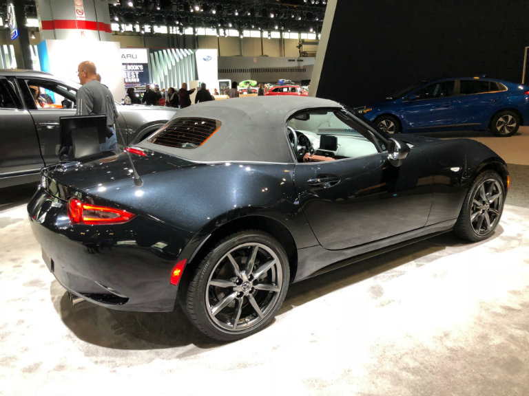 Side View Of The 2018 Mazda MX 5 Miata Soft Top In Black At The