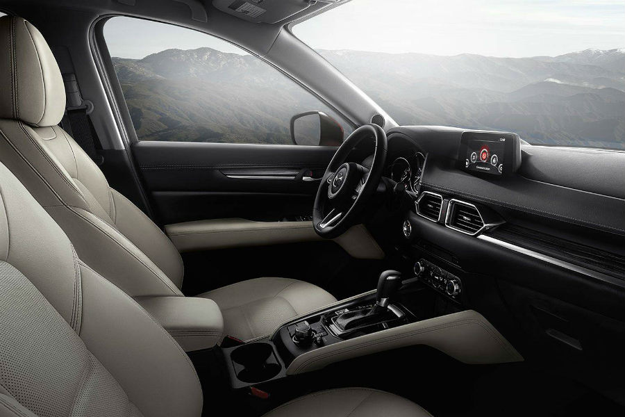A photo showing what is available in the front seat of the 2018 CX-5.