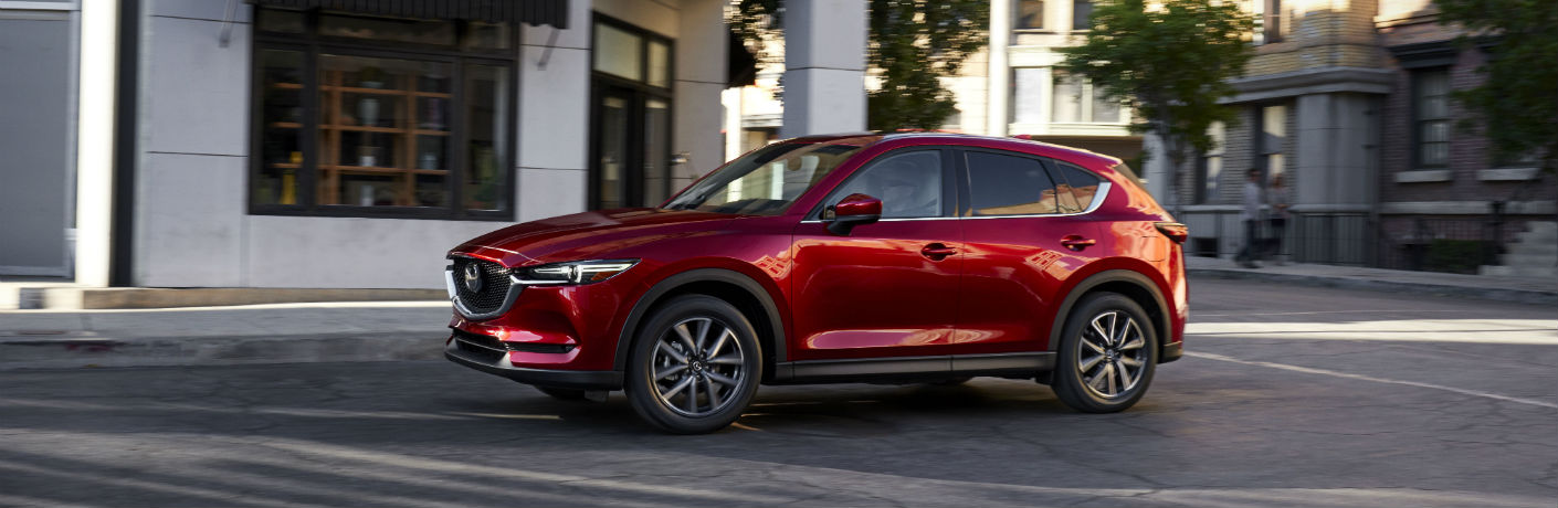 2017 mazda cx-5 red parked on street