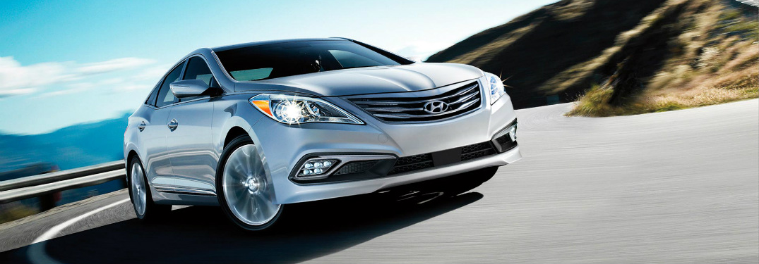 silver 2017 Hyundai Azera making a left turn around a corner